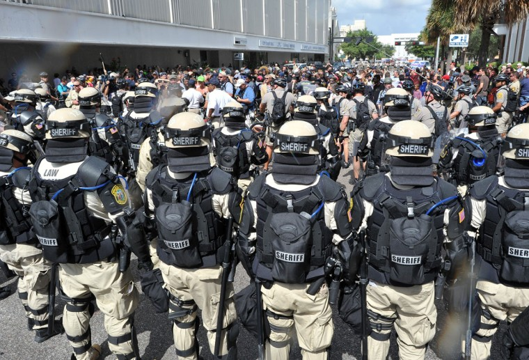 Police in riot gear stop an anti-GOP march from approaching the Tampa Bay Times Forum during a protest rally in Tampa, Florida. (Mladen Antonov/AFP/Getty Images)