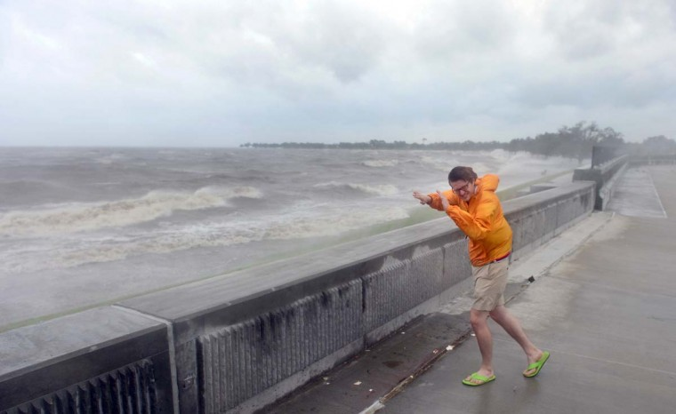 Evan Stoudt faces strong winds while visiting the banks of Lake Pontchartrain in New Orleans in Louisiana, where Hurricane Isaac has made landfall. (Frederic J. Brown/Getty Images)