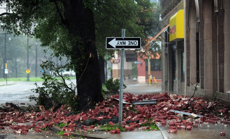 A street sign is turned upside down likely resulting from bricks falling overnight from a building along the deserted streets of New Orleans, Louisiana on August 29, 2012. (Frederic J. Brown/AFP/Getty Images)