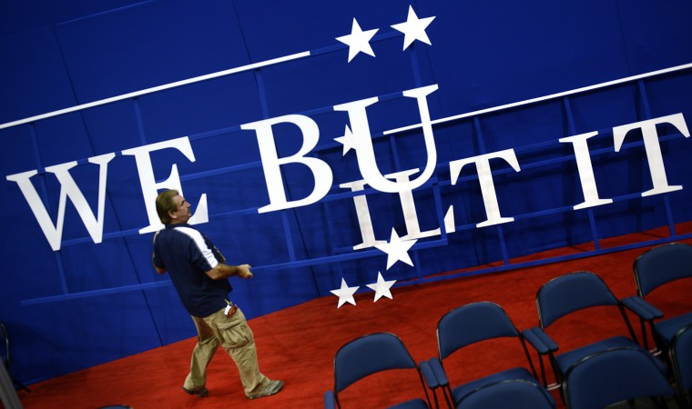 "Marc Sobas removes a ""We Built It"" sign before the third day of the 2012 Republican national Convention at the Tampa Bay Times Forum August 29, 2012 in Tampa, Florida. (Brendan Smialowski/AFP/Getty Images)"