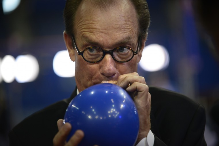 Treb Heining, a balloon consultant with the GlassHouse Balloon Company, demonstrates inflating a balloon before the third day of the 2012 Republican National Convention. (Brendan Smialowski/AFP/Getty Images)