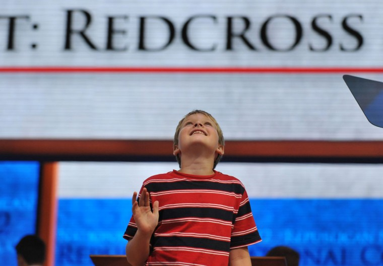 GOP Vice presidential nominee Paul Ryan's son Sam looks up at the ceiling where hundreds of balloons are kept in nets during a sound check at the Tampa Bay Times Forum in Tampa, Florida, on August 29, 2012 before the day's Republican National Convention (RNC) events. (Steve Honda/AFP/Getty Images)