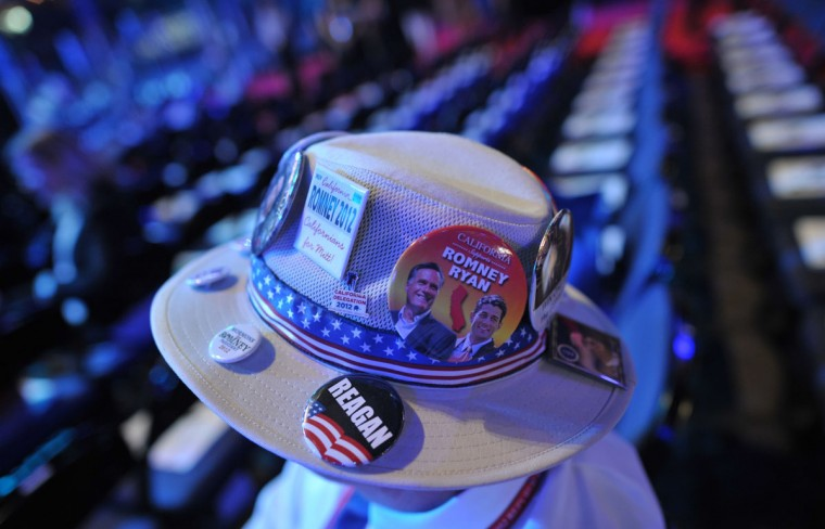 A delegate wears a hat with party pins at the Tampa Bay Times Forum in Tampa, Florida, on August 29, 2012 ahead of the day's Republican National Convention (RNC) events. (Mladen Antonov/AFP/Getty Images)