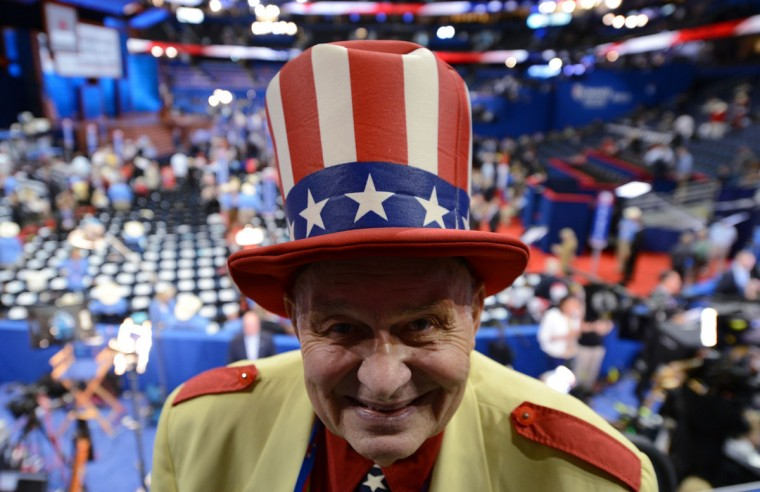 Oscar Poole from Georgia poses with a red, white and blue top hat at the Tampa Bay Times Forum in Tampa, Florida, on August 29, 2012 ahead of the day's Republican National Convention (RNC) events. (Robyn Beck/AFP/Getty Images)