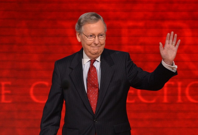 Senate Republican Leader and Convention Temporary Chairman from Kentucky Mitch McConnell waves to the crowd at the Florida, on August 29, 2012 during the Republican National Convention (RNC). (Stan Honda/AFP/Getty Images)