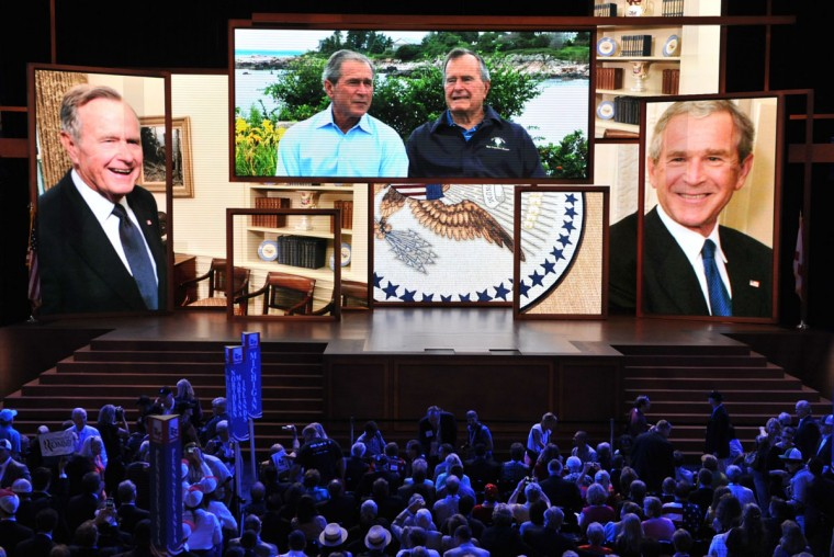 Video of former presidents George Bush, father and son, is on display on the multiple giant screens at the Tampa Bay Times Forum in Tampa, Florida, on August 29, 2012 during the Republican National Convention (RNC). (Stan Honda/AFP/Getty Images)