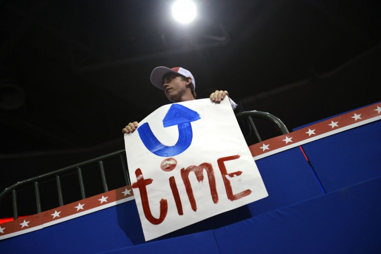 A convention goer holds up a sign at the Tampa Bay Times Forum in Tampa, Florida, on August 29, 2012 during the Republican National Convention (RNC). (Brendan Smialowski/AFP/Getty Images)