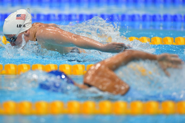 U.S. swimmer Jessica Long, top, competes in the women's 100m butterfly during the London 2012 Paralympic Games. (Ben Stansall/AFP/Getty Images)