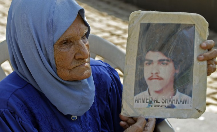 Lebanese women hold pictures of relatives who are thought to be held in Syrian prisons or are missing since the Lebanese civil war (1975-1990) during a sit-in to demand their release and the knowledge of their whereabouts. (Anwar Amro/AFP/Getty Images)