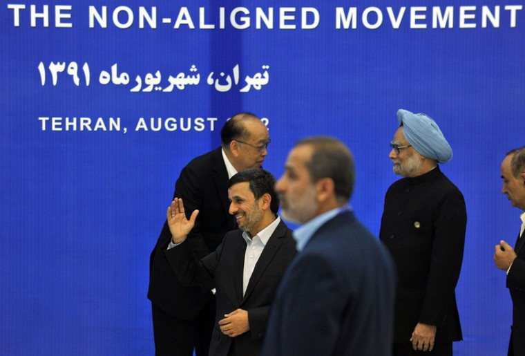 Iranian leader Mahmoud Ahmadinejad, center, greets other leaders and delegates of the Non-Aligned Movement (NAM) as they arrive before the start of the NAM summit in Tehran. (Amir Kholousi/AFP/Getty Images)