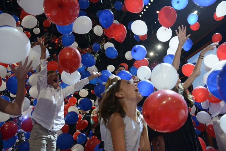 The children and grand children of Republican presidential candidate Mitt Romney and Vice presidential nominee Paul Ryan enjoy the hundreds of balloons on stage at the Tampa Bay Times Forum in Tampa, Florida on the final day of the Republican National Convention (RNC). (Brendan Smialowski/AFP/Getty Images)