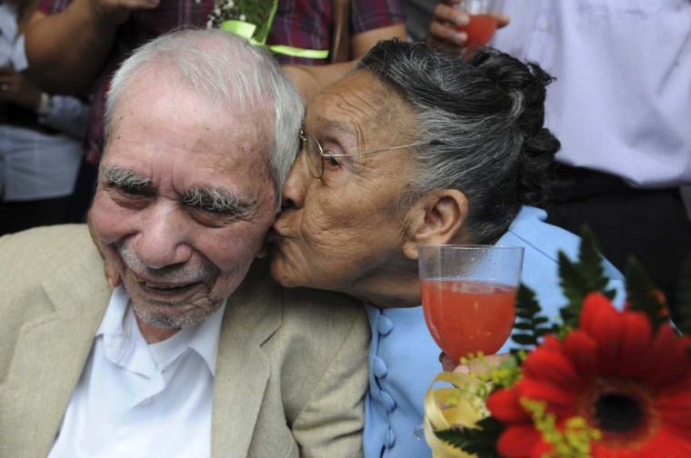 Ana Borjas (75) kisses her husband Luis Garcia(87) during the wedding of 412 couples during the Free Wedding ceremony in Tegucigalpa, Honduras. (Orlando Sierra/Getty Images)