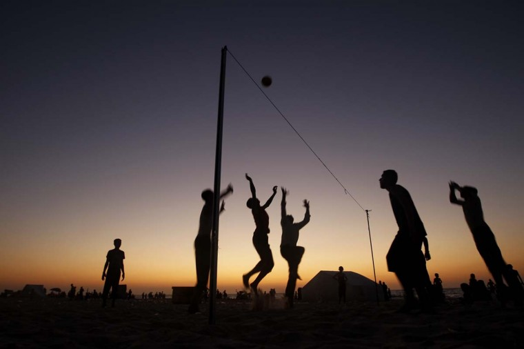 Palestinians play beach volleyball in Gaza City on August 31, 2012. (Mohommed Abed/Getty Images)