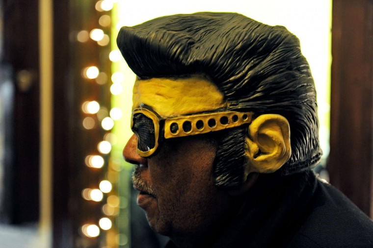 December 3, 2011: Henry Tate donned an Elvis Presley mask at the annual Night of 100 Elvises at the Lithuanian Hall. (Colby Ware/Baltimore Sun)