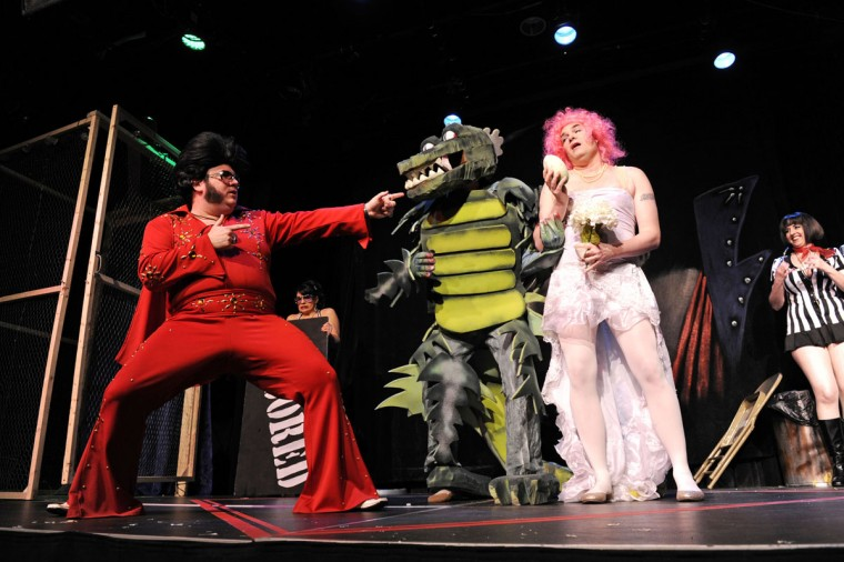 January 14, 2012: Jared Davis, as Elvis, marries Godzilla and the bridezilla at the Elvis Birthday Fight Club at Creative Alliance. (Colby Ware/Baltimore Sun)