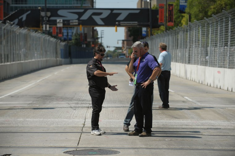 Aug. 31: Grand Prix of Baltimore officials, the track builder and Michael Andretti (L) look at options by the Light Rail tracks at Howard and Pratt Street. The cars were going airborne over the tracks where last year a chicane (a series of speed bumps) was placed. (Gene Sweeney Jr./Baltimore Sun)