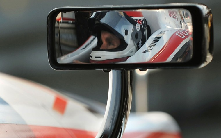 Team Penske driver Will Power is reflected in his side mirror as he awaits the start of the 2nd afternoon practice session, at the Mid-Ohio race course, in preparation on August 3, 2012. (Gene Sweeney Jr./Baltimore Sun)