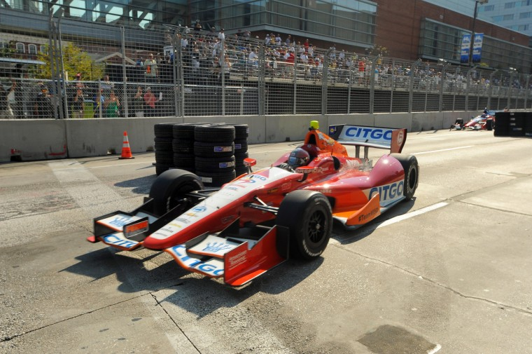IndyCar series driver E.J. Viso passes a temporary chicane installed on Pratt Street by Howard and Light Streets. The chicane was added because cars were going airborne when passing over the tracks. (Gene Sweeney Jr./Baltimore Sun Photo)