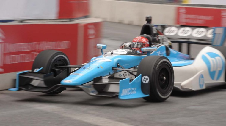 IndyCar driver Simon Pagenaud, who caught air on the railroad tracks in Pratt Street on Friday, rounds a turn during Saturday morning's practice session. (Gene Sweeney Jr./Baltimore Sun Photo)