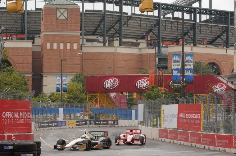 Conditions were wet for part of the IndyCar series morning practice session. Here, drivers come around a turn with Camden Yards in the background. (Gene Sweeney Jr./ Baltimore Sun Photo)