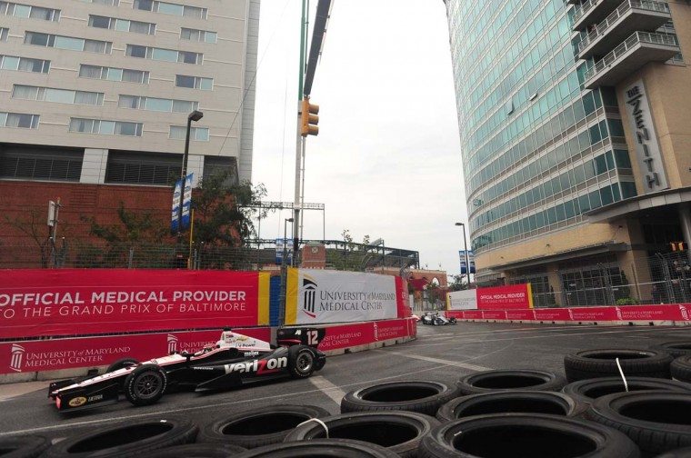 Shown is Will Power, from the Indycar series morning practice, partially in the wet conditions, turning onto Pratt Street. (Gene Sweeney Jr./Baltimore Sun)