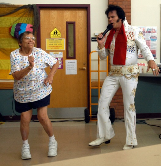 July 22, 2004: Elvis impersonator Tom Connelly visits the center's Hawaiin Luau party at the Westminster Senior Activity Center. Here, he dances with Connie Kosakowski, 79, of Westminster. (Barbara Haddock Taylor/Baltimore Sun)
