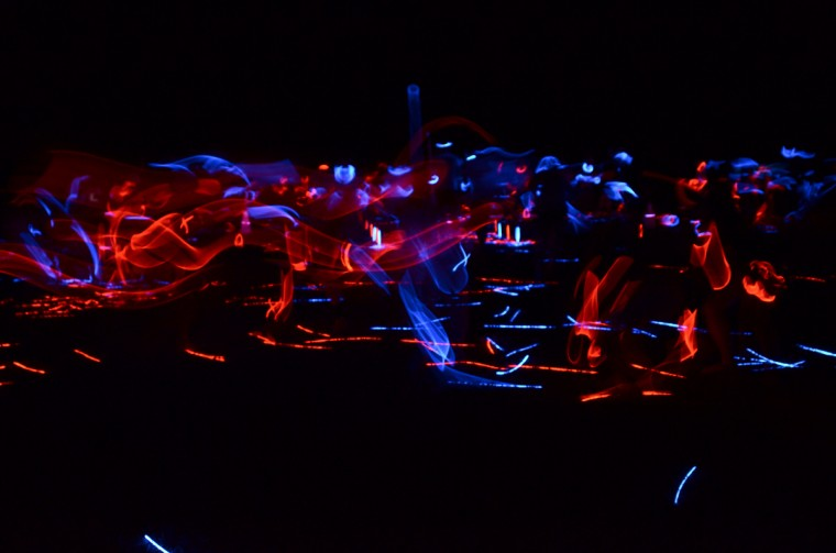 Chaos ensues on the battlefield during the Color War 'Illumination' event, which involved the entire camp and thousands of glow sticks. (Jon Sham)