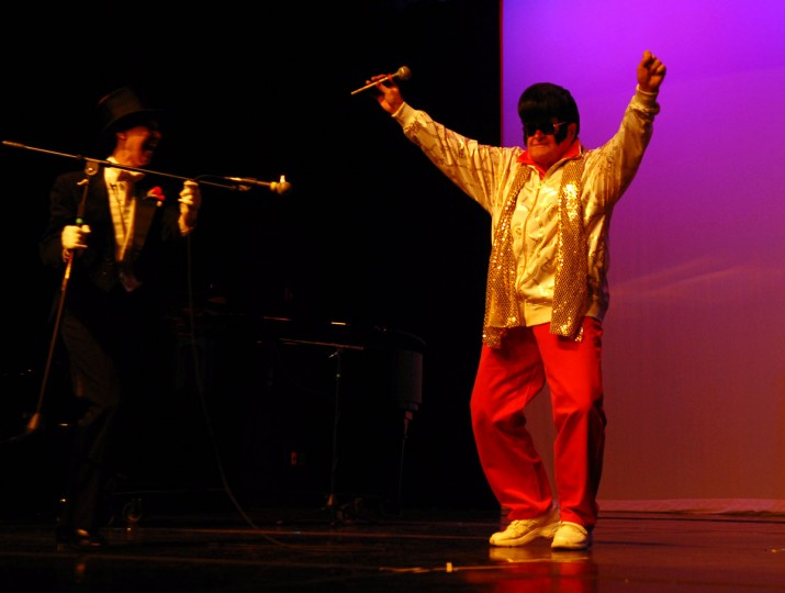 November 27, 2007: Leo Mahoney, 78, showed up as Elvis during the third annual Maryland Senior Idol 2007. Ella Shields (LT), M.C. of the event, couldn't help laughing. (Chiaki Kawajiri/Baltimore Sun)