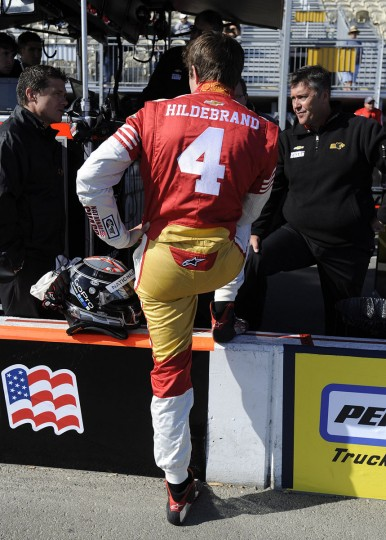 IndyCar driver JR Hildebrand (4) shows off his San Francisco 49ers racing suit while in the pits before the Indy Grand Prix of Sonoma at Sonoma raceway in Sonoma, California, on Sunday, August 26, 2012. (Jose Carlos Fajardo/Contra Costa Times/MCT)