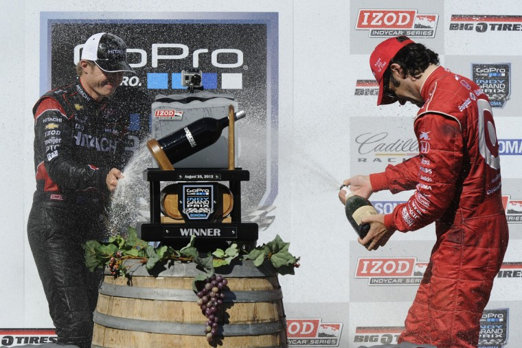 IndyCar driver Ryan Briscoe (2), left, sprays champagne at Dario Franchitti, (10), right, after winning the Indy Grand Prix of Sonoma at Sonoma raceway in Sonoma, California on Sunday, August 26, 2012. Briscoe placed first, Will Power placed second and Franchitti placed third. (Jose Carlos Fajardo/Contra Costa Times/MCT)