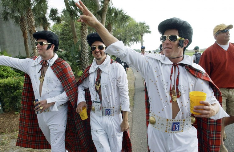 April 19, 2008: A trio of Elvis impersonators with tartan capes, from left, Shane Allison, Dean Pirtle and Matt Raven, wave to fans as they walk along the 18th fairway during the third round of the Verizon Heritage at Harbour Town Golf Links on Hilton Head Island, South Carolina. The three were declared the winners of the tournament's Tartan Day competition. (Jay Karr/The Island Packet/MCT)