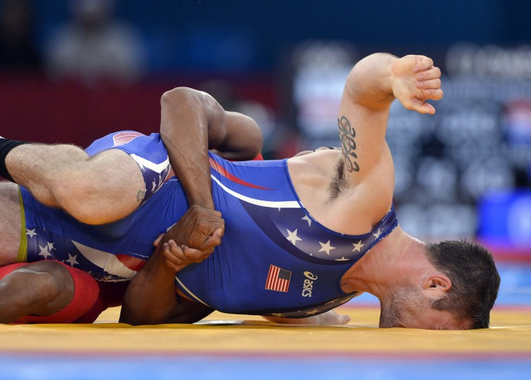 USA's Benjamin Provisor, right, has his face planted into the mat as he wrestles Cuba's Alexei Bel in a men's Greco-Roman 74 kg class qualification match at the ExCeL Centre during the 2012 Summer Olympic Games in London, England, Sunday, August 5, 2012. Provisor defeated Bela, 3-1 pp. (David Eulitt/Kansas City Star/MCT)