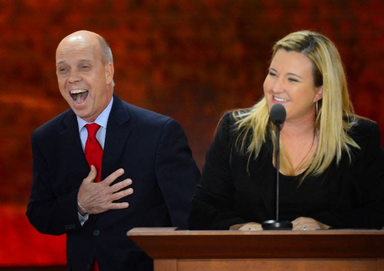 Scott Hamilton is brought to the stage by fellow Olympian Kim Rhode at the Republican National Convention at the 2012 Republican National Convention in the Tampa Bay Times Forum in Tampa, Florida. (Harry E. Walker/MCT)