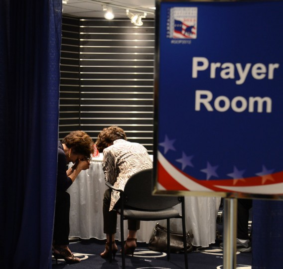 Attendees pray in a prayer room at the 2012 Republican National Convention at the Tampa Bay Times Forum in Tampa, Florida. (Lionel Hahn/Abaca Press/MCT)