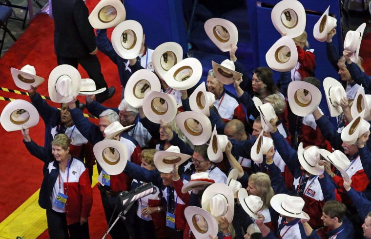 Members of the Texas delegation tip their hats in unison at the Republican National Convention at the Tampa Bay Times Forum in Tampa, Florida. (Louis DeLuca/Dallas Morning News/MCT)