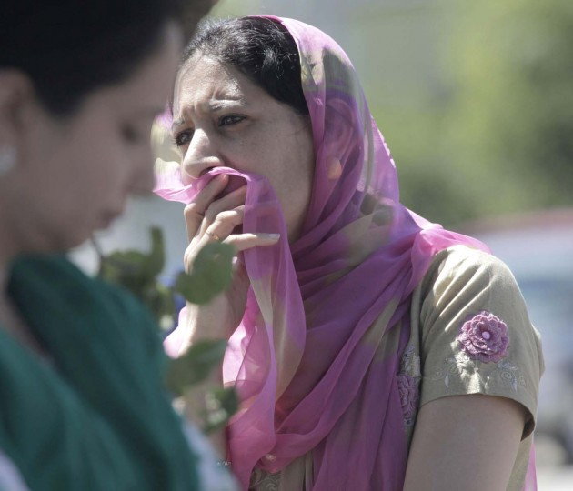 OAK CREEK, WI - AUGUST 5: A woman looks on near the scene of a shooting at the Sikh Temple in Oak Creek, Wisconsin, Sunday, August 5, 2012. (Mike De Sisti/Milwaukee Journal Sentinel/MCT)