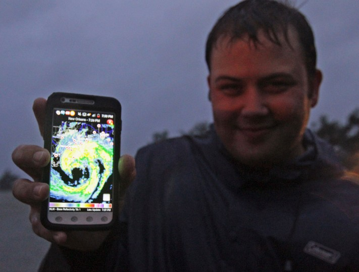 Meteorology student Dylan Cooper of Monroe, Louisiana, shows a satellite photo of Hurricane Isaac on his phone while watching the storm in Lakeshore, Mississippi, August 28, 2012. (John Fitzhugh/Biloxi Sun Herald/MCT)