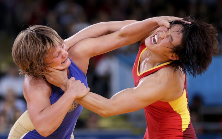 China's Ruixue Jing (in red) fights with Russia's Lubov Volosova on the Women's 63Kg Greco-Roman wrestling at the ExCel venue during the London 2012 Olympic Games. (Toru Hanai/Reuters)