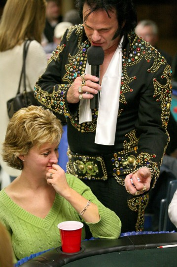 November 6, 2009: Sandy Barrass (lower left), an Ascension allumni, of Halethorpe, reacts as Elvis (impersonated by Tom Connelly of Pasadena) snatches up some of her poker chips as he sings a song during a casino night fundraiser, held at The Ascension School in Halethorpe on Friday night. (Kitty R Charlton/Patuxent Publishing)
