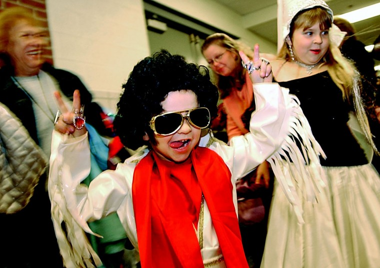 October 28, 2005: Jesse Kocher, 4, of Loch Raven shows off his Elvis Presley costume with his sister, princess Clarissa Kocher, 9, right at a Halloween costume parade at Pleasant Plains Elementary School. (Steve Ruark/Patuxent Publishing)