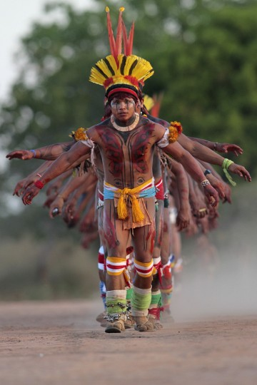 Yawalapiti men dance during the celebration of this year's 'quarup,' a ritual held over several days to honour in death a person of great importance to them, in the Xingu National Park, Mato Grosso State. This year the Yawalapiti tribe honoured two people - a Yawalapiti Indian who they consider a great leader, and Darcy Ribeiro, a well-known author, anthropologist and politician known for focusing on the relationship between native peoples and education in Brazil. (Ueslei Marcelino/Reuters)