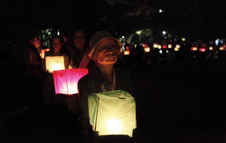 A first generation immigrant from Japan holds a lantern to remember the 67th anniversary of the atomic bombings of the cities of Hiroshima and Nagasaki, at Ibirapuera Park in Sao Paulo August 5, 2012. Sao Paulo has the world's largest Japanese neighborhood outside of Japan. (Nacho Doce/Reuters)