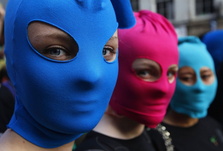 EDINBURGH, SCOTLAND - AUGUST 14: Protesters wearing masks take part in an Amnesty International flash mob demonstration in support of Russian punk band Pussy Riot in the Royal Mile in Edinburgh, Scotland August 14, 2012. (David Moir/Reuters)