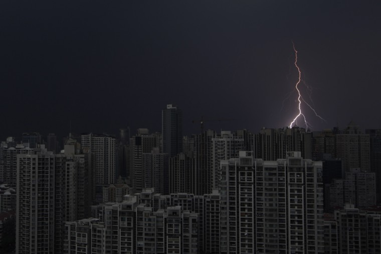 Lightning is seen above buildings during a storm in central Shanghai. (Aly Song/Reuters)