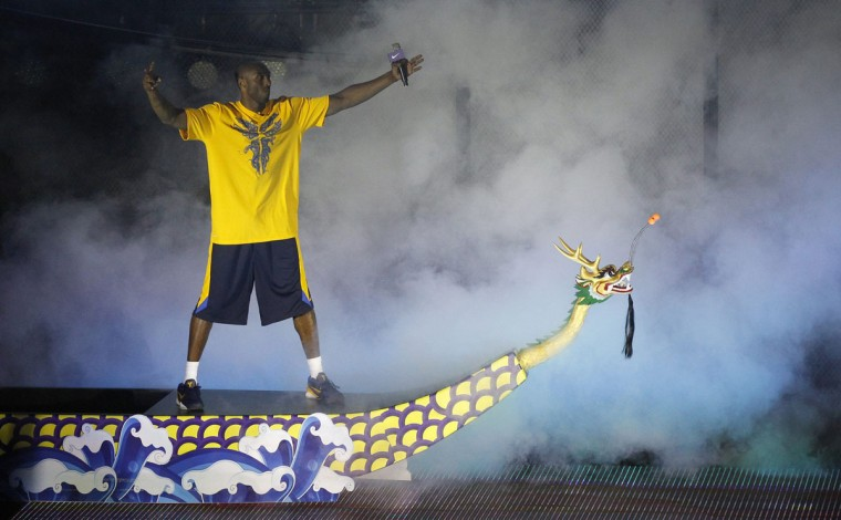 NBA basketball player Kobe Bryant of the U.S. stands on a dragon boat as he shows up during a promotional event in Guangzhou, Guangdong province in China. (Stringer/Reuters)