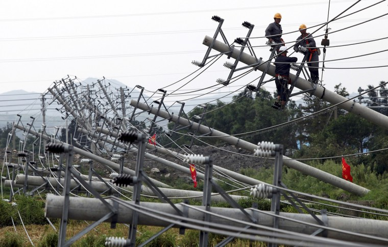 Laborers work to reconnect an electric circuit after pylons were turned over by Typhoon Haikui in Wenling, Zhejiang province. Typhoon Haikui struck China on Wednesday, packing winds of up to 110 km per hour (68 mph), prompting officials to evacuate nearly 2 million people and grounding hundreds of flights to and from (China Daily)