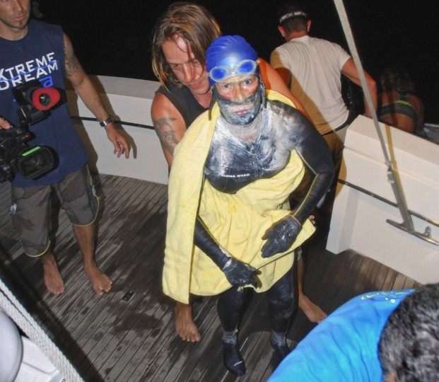 Veteran long-distance swimmer Diana Nyad is aided after she was pulled out of the water between Cuba and the Florida Keys early August 21, 2012. The 62-year-old American, who battled squalls, rough seas and jellyfish, had set out from Cuba on Saturday had spend more than 60 hours in the water before she abandoned the swim. (Christi Barli/The Florida keys News Bureau/Handout/Reuters)