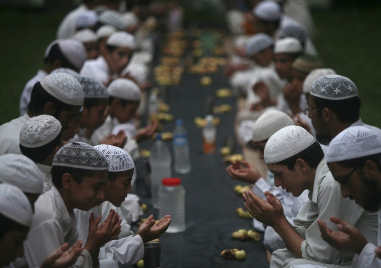 Muslims offer prayers before having their Iftar (fast-breaking) meal during the holy month of Ramadan at a madrasa or religious school on the outskirts of Jammu. (Mukesh Gupta/Reuters)