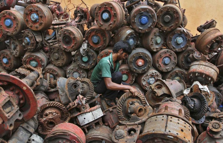 A man works at an iron scrap yard at an industrial area in the southern Indian city of Chennai. India's industrial output fell for the third time in four months in June, adding to pressure on new Finance Minister Palaniappan Chidambaram to move quickly and pull Asia's third-largest economy from its worst slowdown in almost a decade. (Babu/Reuters photo)