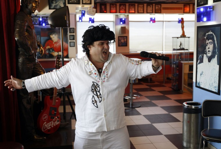 August 16, 2010: An Elvis Presley impersonator performs at a restaurant in Neve Ilan, near Jerusalem, to mark the 33rd anniversary of Presley's death. (Ronen Zvulun/Reuters)